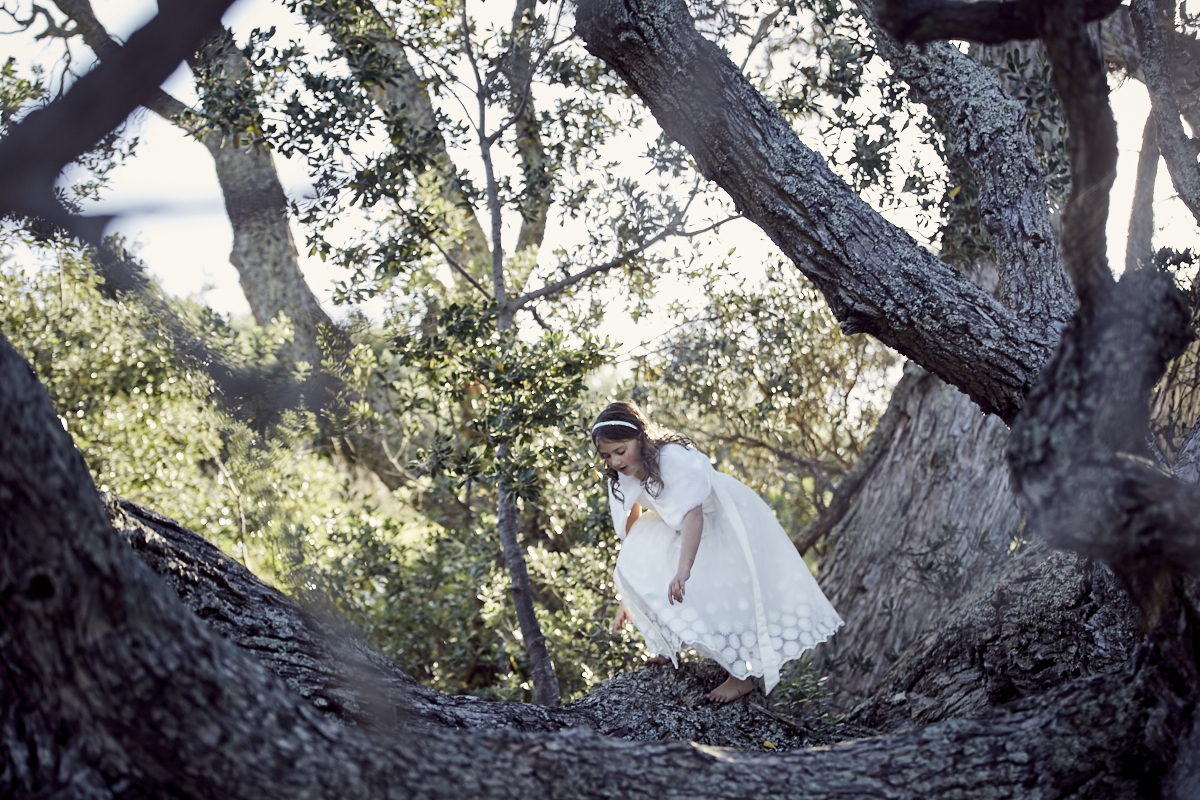 flower girl climbing tree
