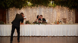 Guest takes photo of newlyweds