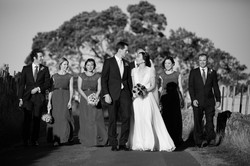 the bridal party walking