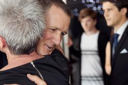 Groom gives a hug