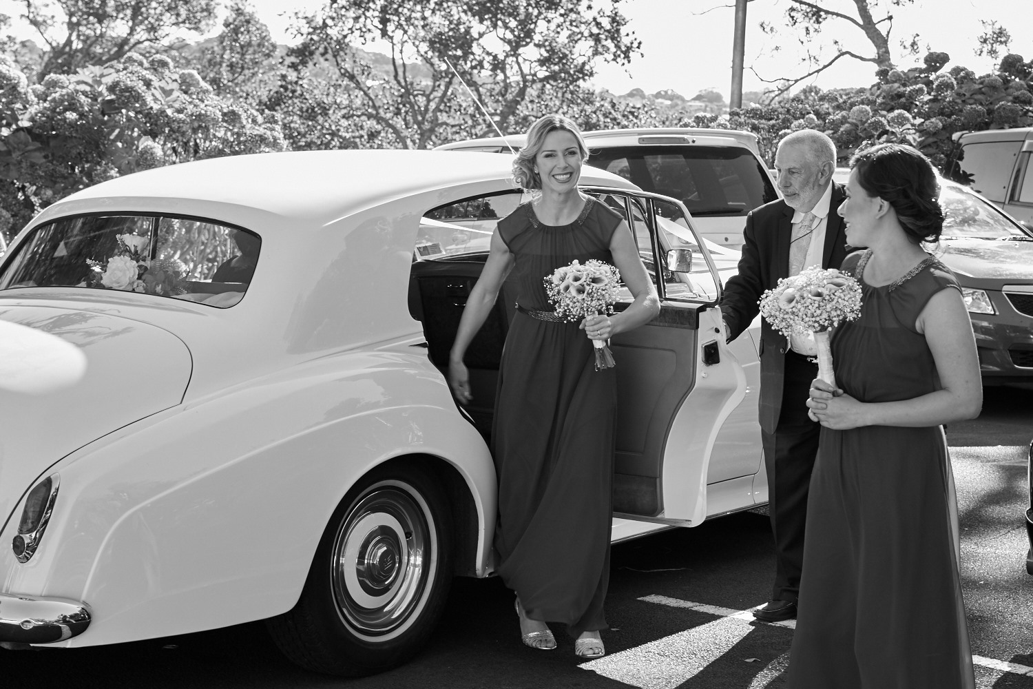bridesmaid gets out of car