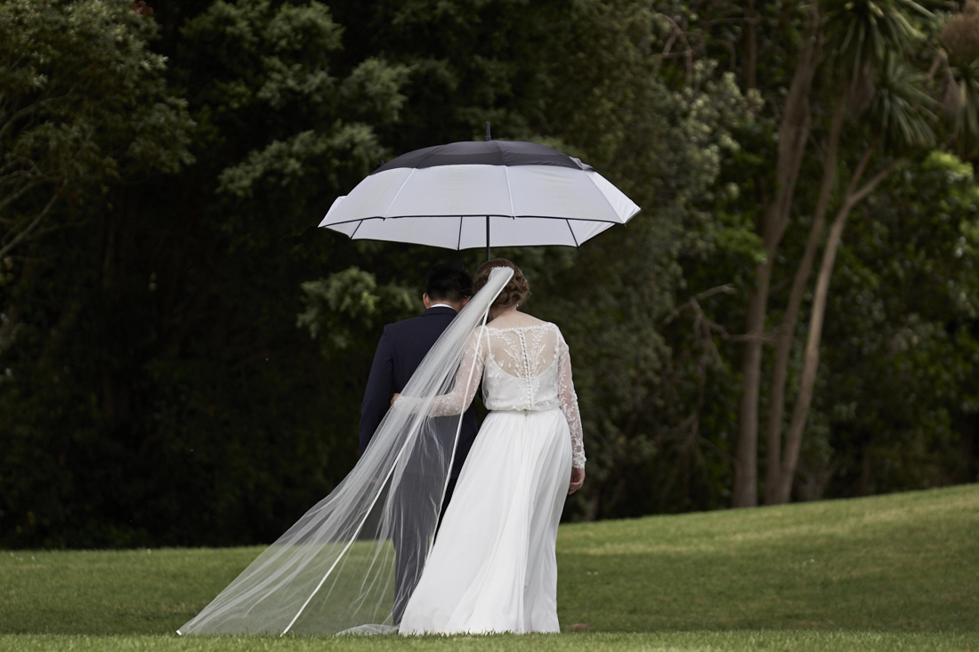 newlyweds with umbrella