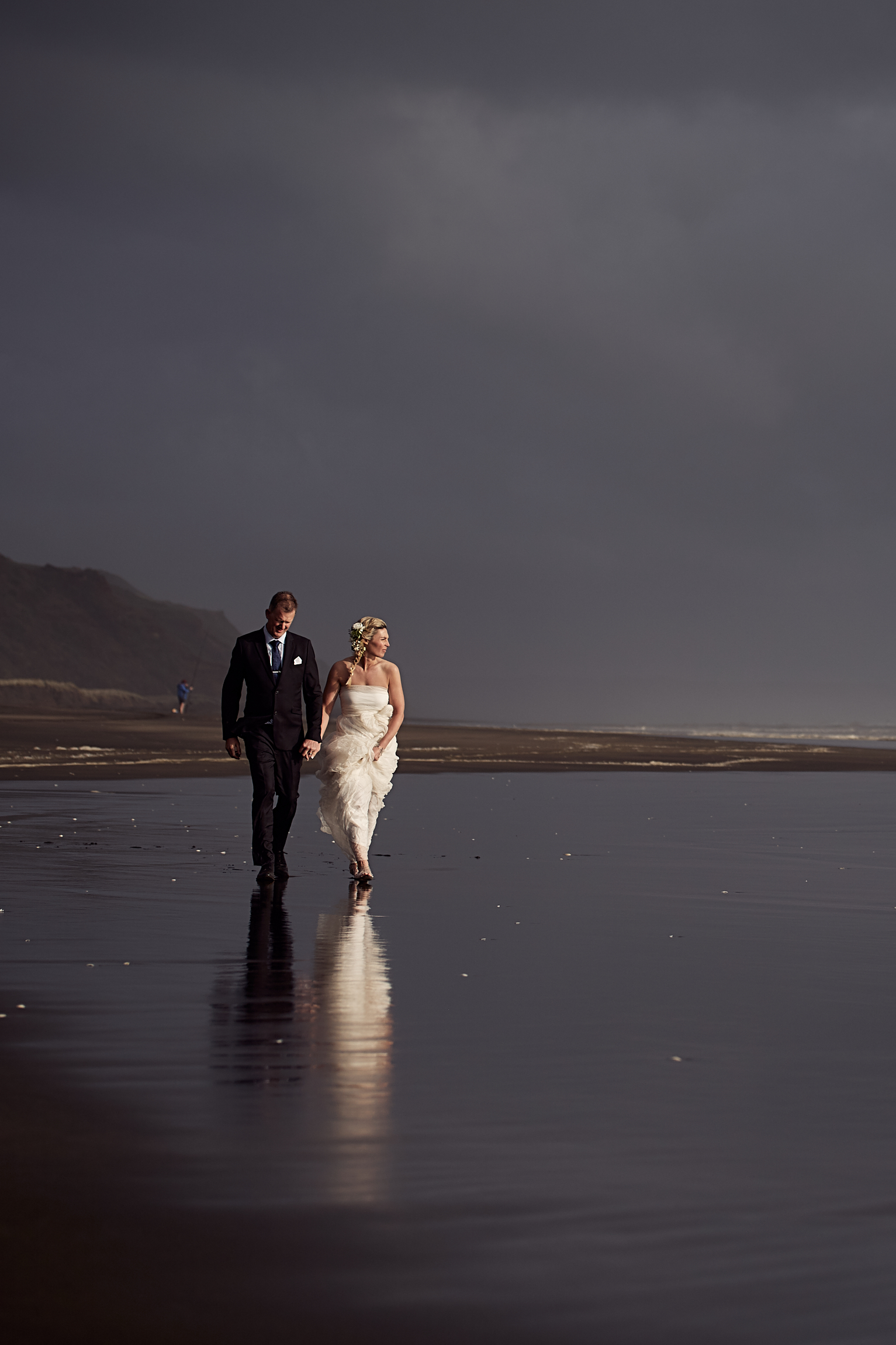 newlyweds strolling along beach