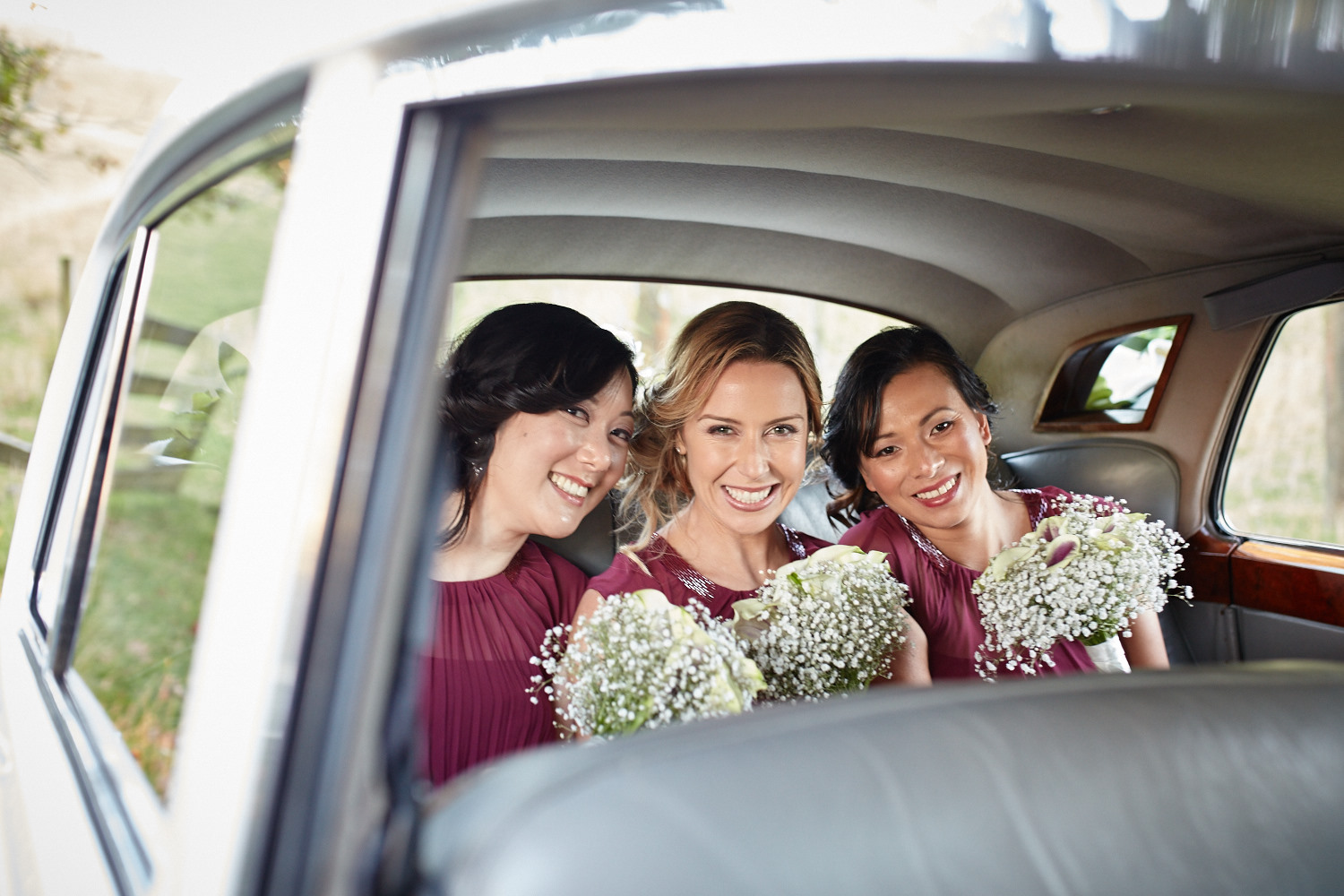 three girls in the wedding car
