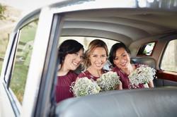three girls in the wedding car