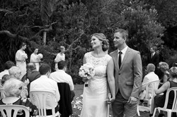 Happy bride and groom smiling