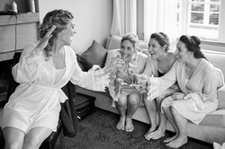bride has a glass of champagne