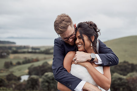 newlyweds embrace at Kauri Bay
