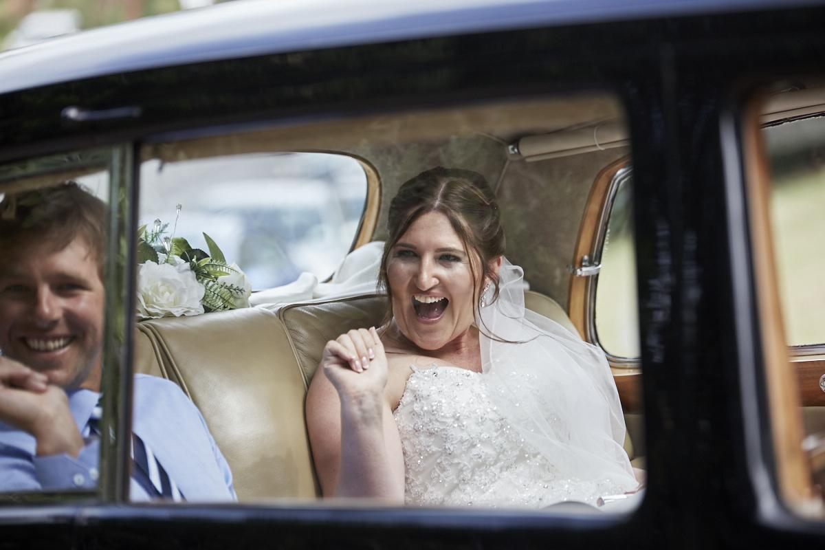 happy bride in car