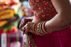 bride adjusting garment