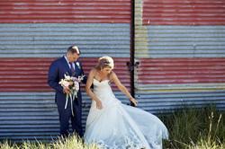 bride adjusts her dress