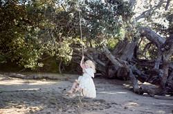 flower girl on swing