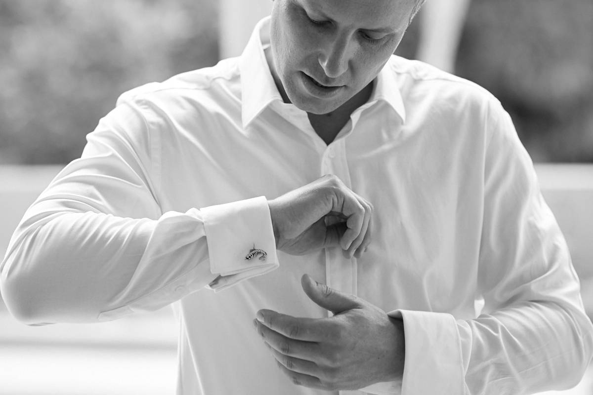 Groom adjusting his cufflinks
