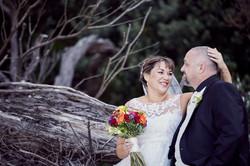 bride touching grooms head