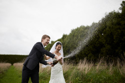 groom opens champagne