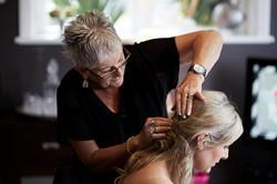 mum fixes bride's hair