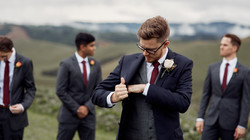 Groom adjusting suit