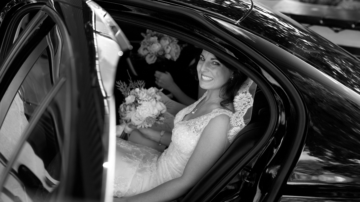 The bride gets out of car