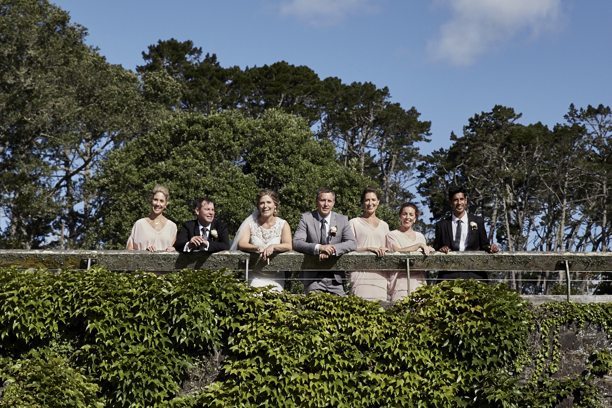 the bridal party on a bridge