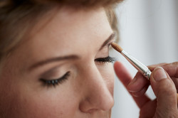 make up being applied to the bride