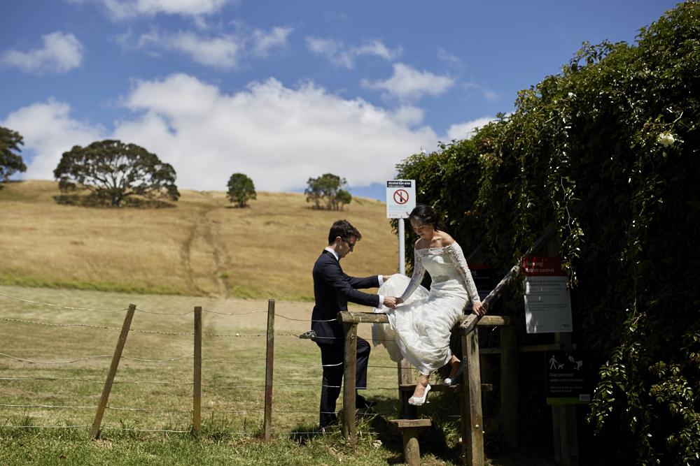 bride climbs fence