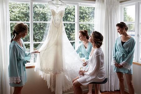 Bride admiring her stunning dress