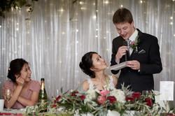the groom reading his speech