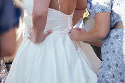 Adjusting bride's dress
