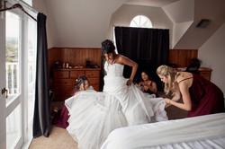 Bride gets into dress