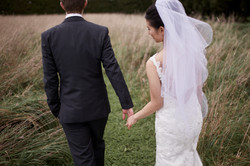 Holding hands in a field