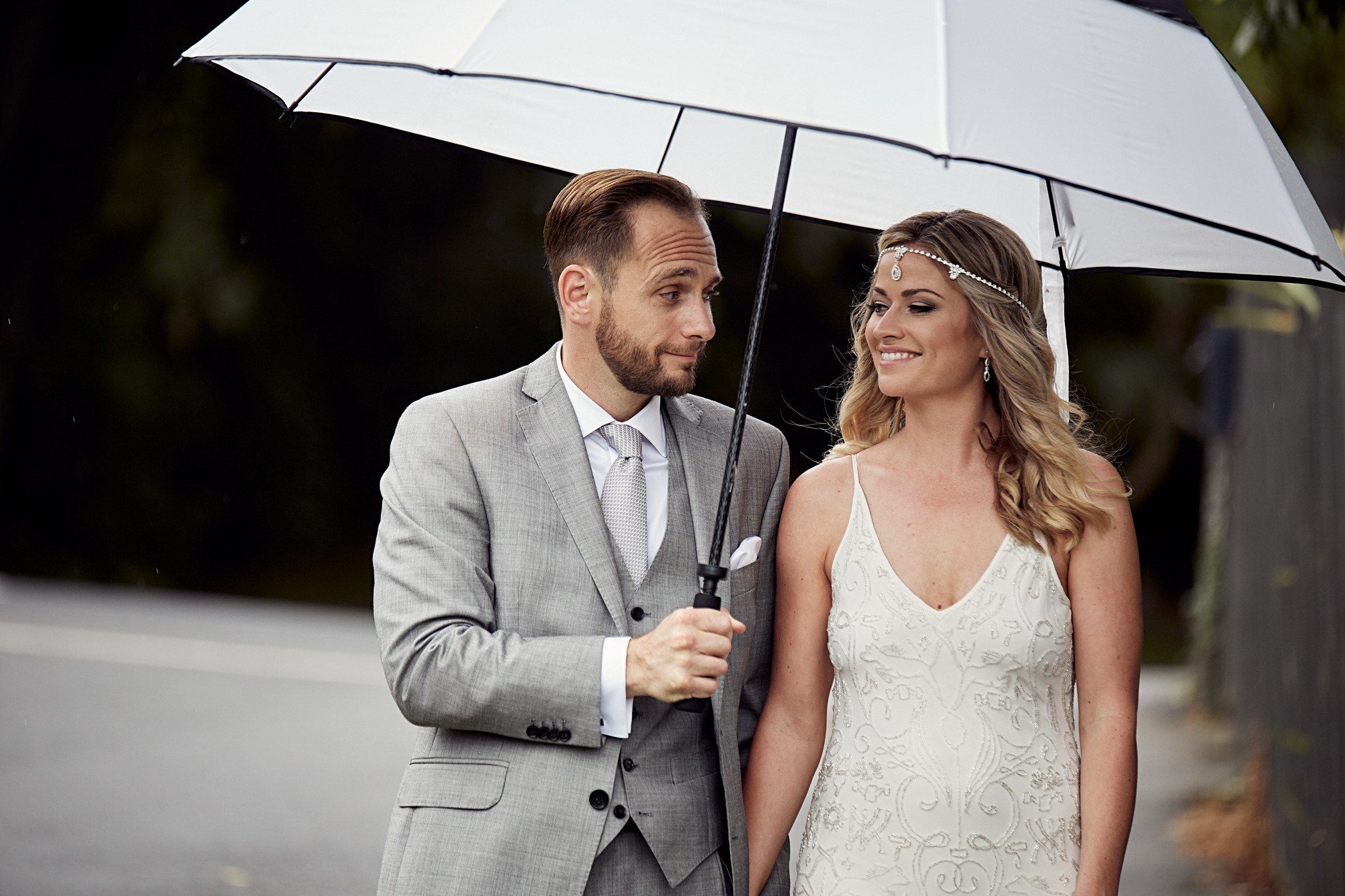 Newlyweds under an umbrella
