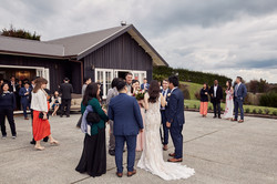 Guest congratulate newlyweds