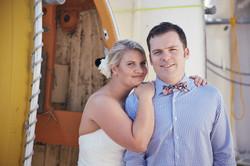Bride on grooms shoulder
