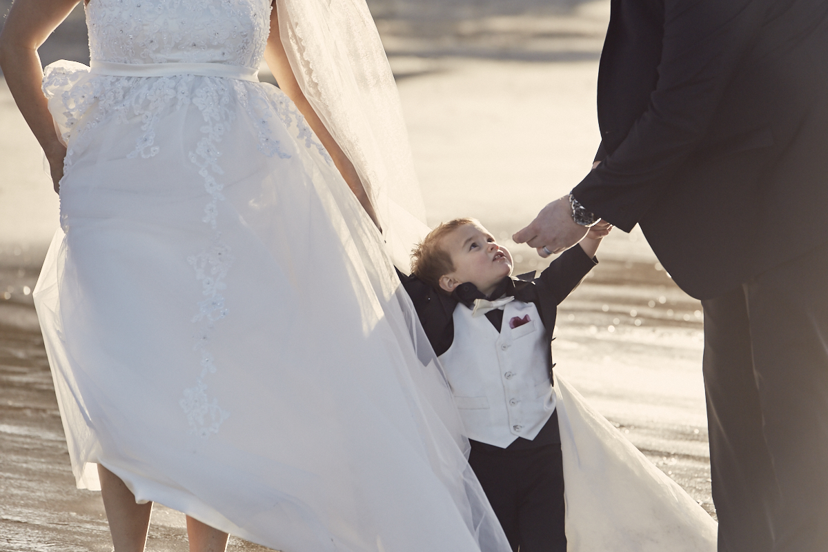 child looking at groom
