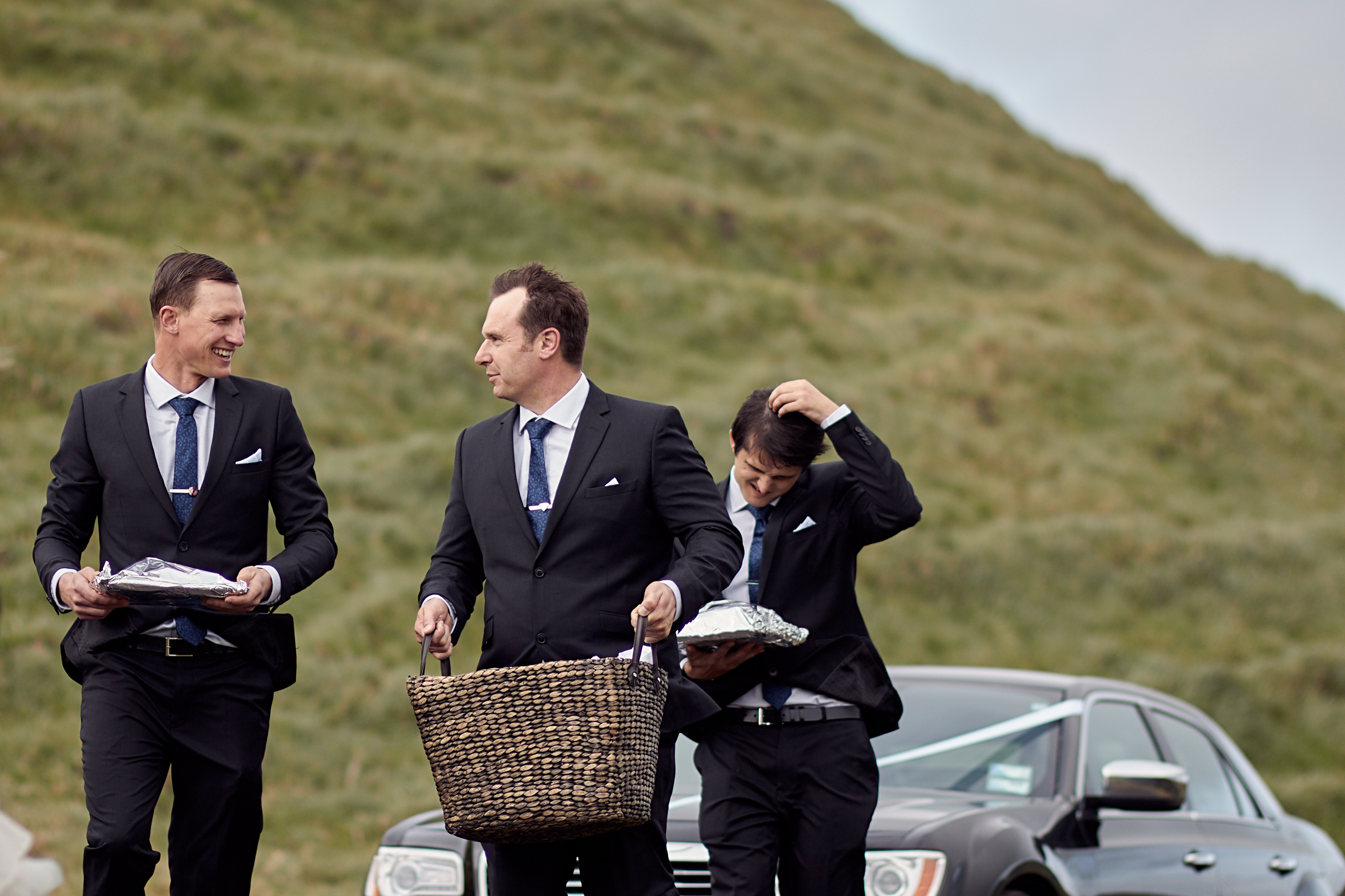 groomsmen carrying baskets