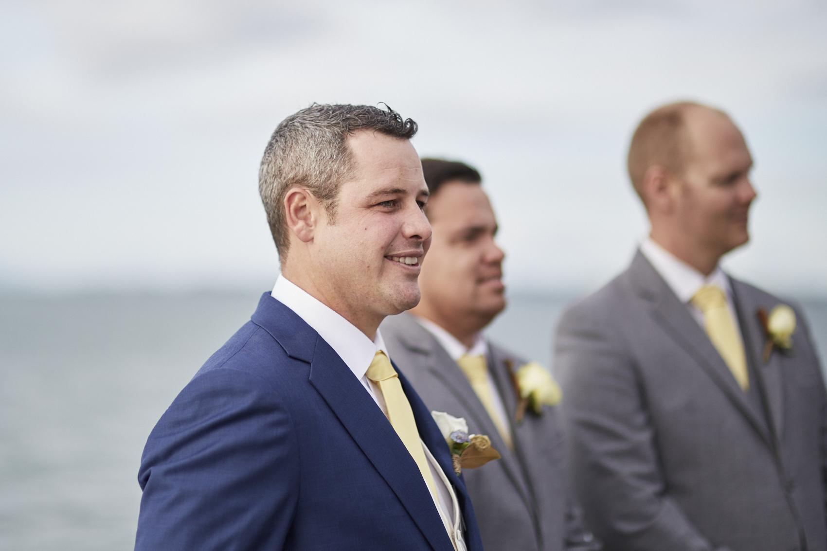 Groom watching for bride