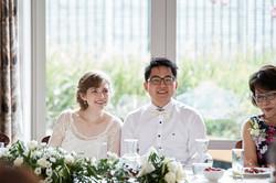 newlyweds listen to speech