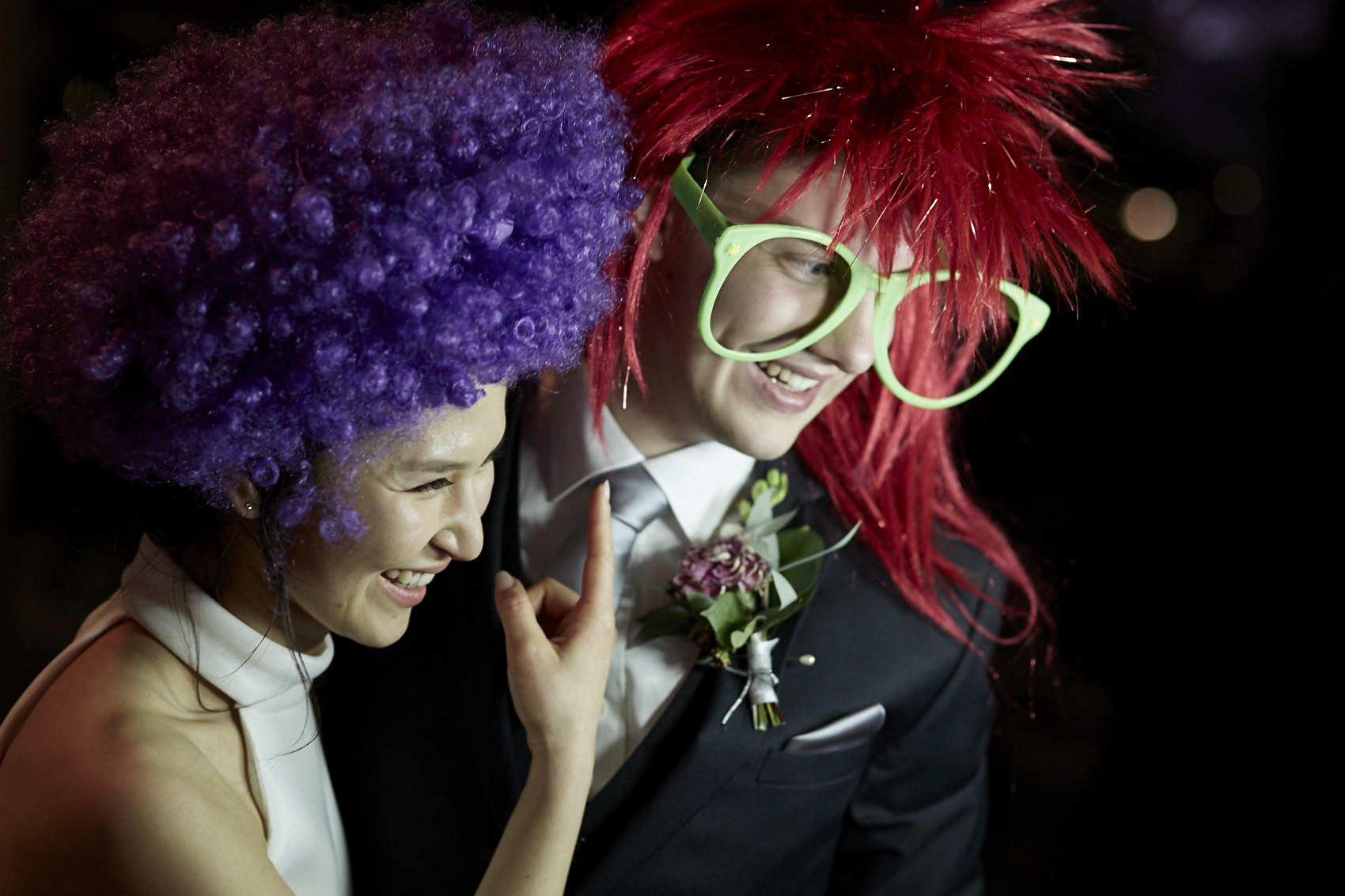 bride and groom with wigs on
