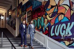 graffiti wall and newlyweds