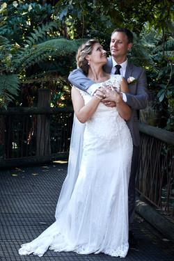 Groom hugs bride
