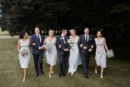 bridal party walking in park