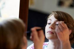 bride applying make up