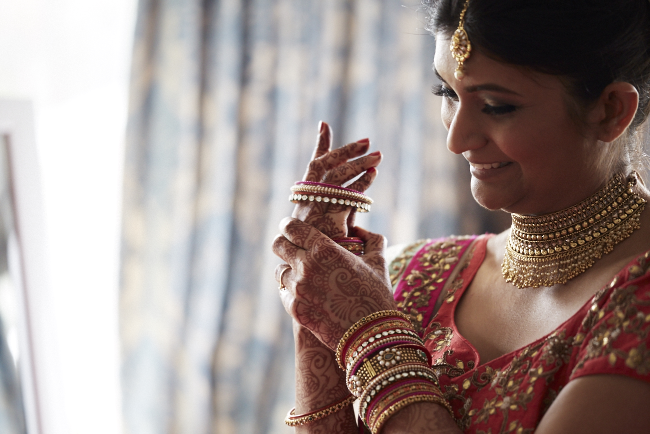 bride putting on bangles