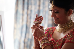 bride putting on bangles
