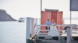 Couple posing on wharf