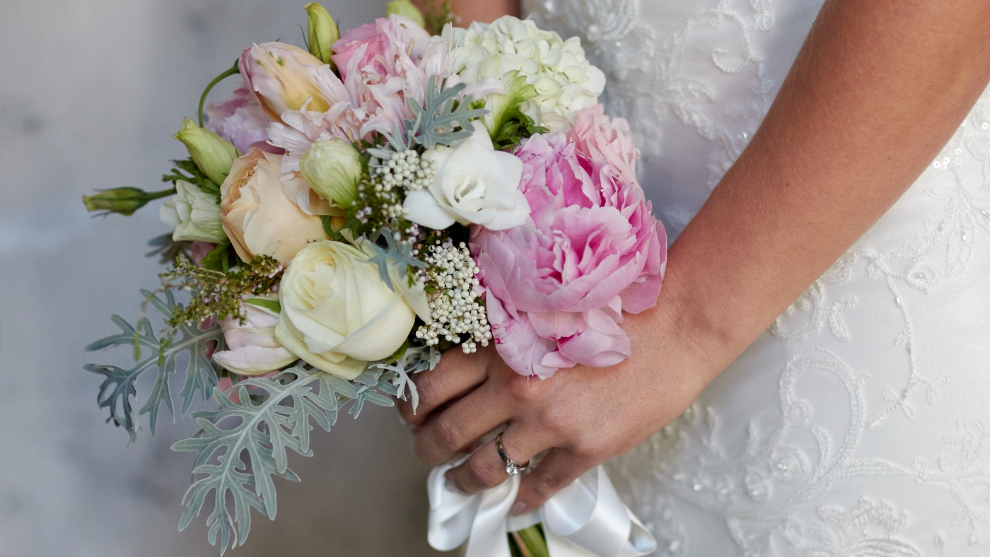 The bride and her wedding flowers