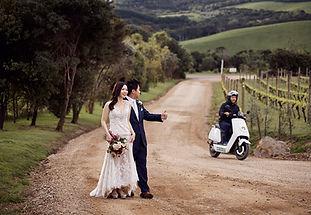 Wedding couple hitch hiking