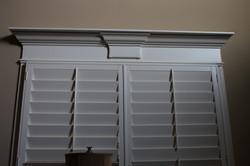 Keystone style with plantation shutters.