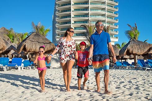Family Walking in the Beach.jpg