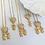 Thumbnail: Colar Coração Filhos Cravejado Com Zirconias e Folheado a Ouro 18k